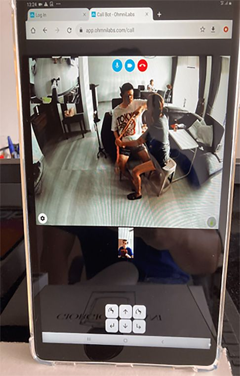 A telepresence robot being used during a home therapy session.